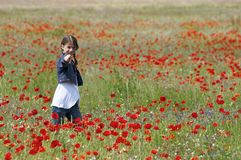 Girl with poppies pointing Royalty Free Stock Photo