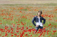 Girl with poppies posing happily Stock Images