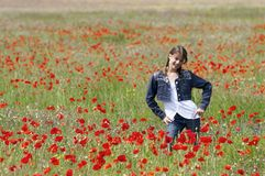 Girl with poppies posing Royalty Free Stock Photos