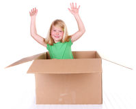 Girl popping out of box Stock Image