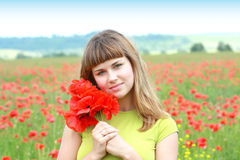 Girl in the poppy field Royalty Free Stock Images