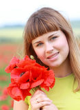 Girl in the poppy field Stock Photos