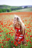 Girl in poppy field Stock Photography