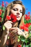 Girl in poppy field stock photo