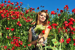 Girl in poppy field Royalty Free Stock Photo