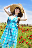 Girl in poppy field Stock Photos