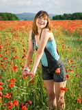 Girl in poppy field Royalty Free Stock Images
