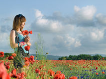 Girl in poppy field Royalty Free Stock Image