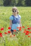 girl in poppy field Stock Photos