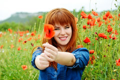Girl with poppy Royalty Free Stock Image