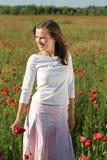 Girl in poppy field Stock Image