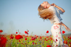 Girl in poppy field Royalty Free Stock Photography