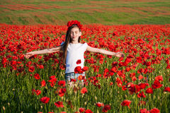 Girl in the poppy field Stock Photography