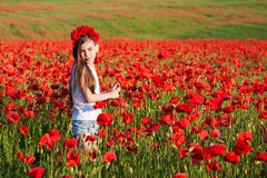 Girl in the poppy field Royalty Free Stock Photography