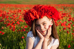 Girl in the poppy field Stock Image