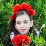 Girl in the poppy field Stock Photo