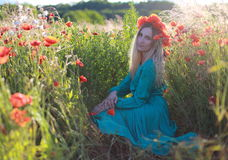 Girl on a poppy field. The girl on a meadow with poppies Stock Photo