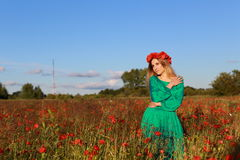 Girl on a poppy field. The girl on a meadow with poppies Stock Images