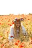 Girl in a poppy field Stock Photos