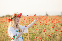 Girl in a poppy field Royalty Free Stock Images