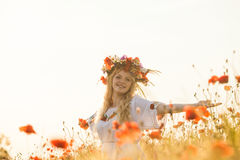 Girl in a poppy field Stock Images