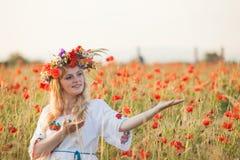 Girl in a poppy field Royalty Free Stock Photo