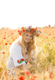 Girl in a poppy field Stock Photography
