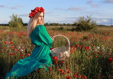 Girl on a poppy field. Relax of the girl in the field with poppies Royalty Free Stock Photos