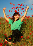 Girl in poppy field. Young wooman in poppy meadow royalty free stock photography