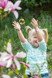 Girl pops the bubbles royalty free stock photography