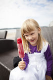Girl with popsicle Royalty Free Stock Photography