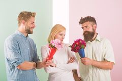 Girl popular receive lot men attention. Men competitors with bouquets flowers try conquer girl. Girl likes to be in. Middle attention. Love triangle. Woman stock images