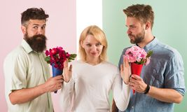Girl popular receive lot men attention. Men competitors with bouquets flowers try conquer girl. Girl smiling reject. Gifts. Feminism concept. Woman smiling royalty free stock image