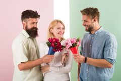 Girl popular receive lot men attention. Men competitors with bouquets flowers try conquer girl. Girl happy likes to be. In middle attention. Love triangle royalty free stock photo