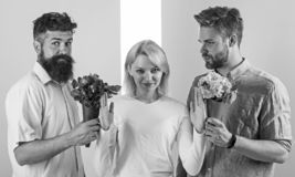 Girl popular receive lot men attention. Men competitors with bouquets flowers try conquer girl. Girl smiling reject. Gifts. Feminism concept. Woman smiling royalty free stock photos