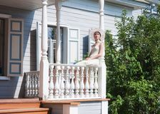 The girl on the porch Royalty Free Stock Photo