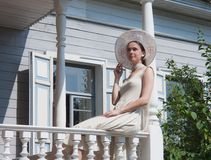 The girl on the porch of the old manor Stock Image