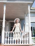 The girl on the porch of the old manor Royalty Free Stock Photos