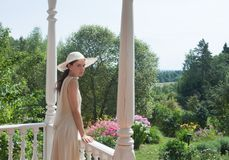 The girl on the porch of the old manor Royalty Free Stock Photo