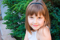 Girl portait. Teen girl portait - summer day, green background, brown hair Stock Photo