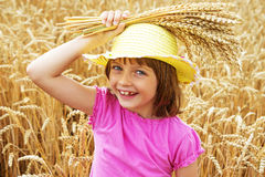 Girl portait in the wheat field Royalty Free Stock Image