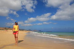 Girl and Porto Santo beach Royalty Free Stock Images