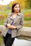 Girl portrait. Portrait of  beautiful young woman in gray coat on the background of autumn park Stock Images