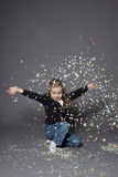 Girl portrait. Portrait of cute girl in a studio with confetti Royalty Free Stock Image