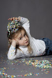 Girl portrait. Portrait of cute girl in a studio with confetti Royalty Free Stock Photography