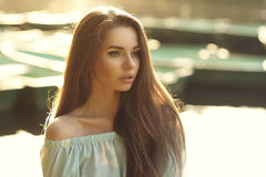 Girl portrait against boats Royalty Free Stock Photo