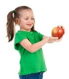 Girl portrait with apple Stock Photos