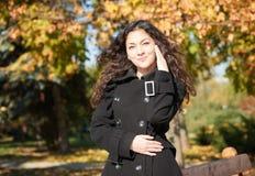 Girl portrait at autumn season in city park Stock Photography