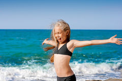 Girl portrait on beach in sport swimming suit Stock Photos