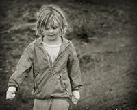 Girl Portrait. Black and white portrait of a girl walking outside Royalty Free Stock Images